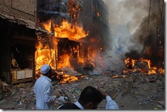 Flame breaks out after an explosion in Peshawar, Pakistan on Wednesday Oct. 28, 2009. A car bomb has torn through a market place in northwestern Pakistan, hours after U.S. Secretary of State Hillary Rodham Clinton arrived in the country. (AP Photo/Mohammad Iqbal)